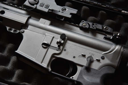 Close-up of a M4A1 (AR-15 model) weapons and military equipment for army, Assault rifle gun on a black case box.