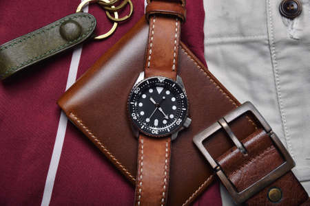 Men fashion and accessories, Wrist watch with brown leather strap, Stylish men stuff, Diving watch with wallet and belt. Imagens