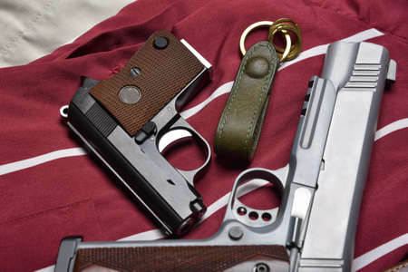 Small gun, .25 caliber automatic handgun, Concealed carry pistols for women self defense, Weapons and military equipment for army. Imagens
