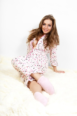 Picture of a morning sweet young girl in pink pajamas.  photo