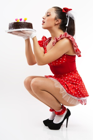wants: A young woman wants to eat chocolate cake. Stock Photo