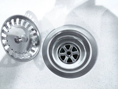Close up photo of water drain, sink drain on white Stockfoto