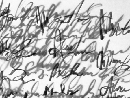 Old unreadable handwriting text on white paper.