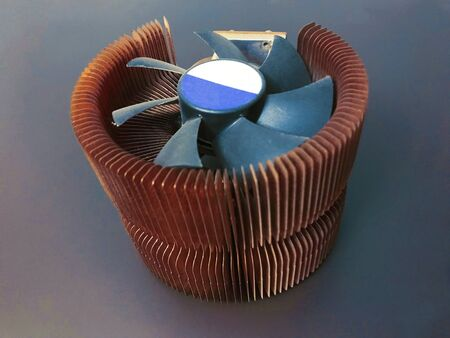 CPU cooler with copper plates on a gray