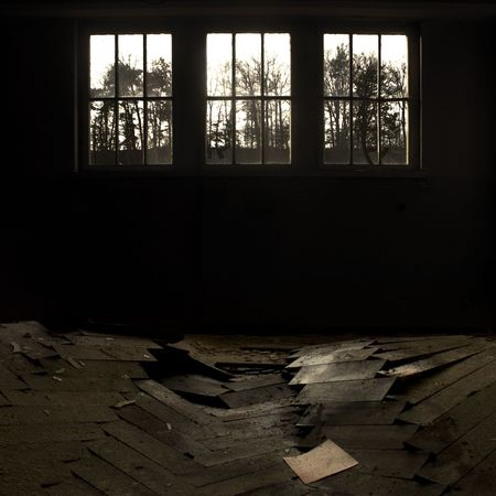kaput: Dark room with brocken strip parquet and sheet