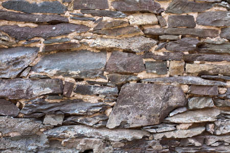 disintegrate: rubblestone, broken quarry stone wall, good background or afterimage Stock Photo