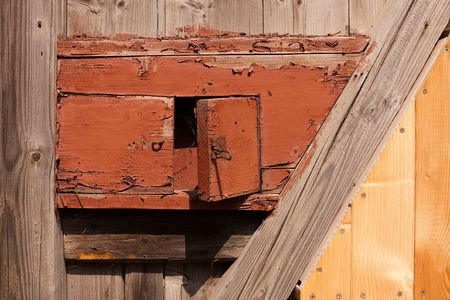 mail slot: old empty wooden letter box with peeling paint