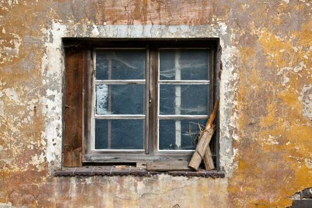 disused: old window from an empty leave house