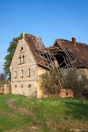 detriment: old empty ruined house with collapse roof