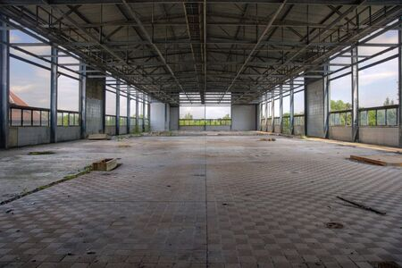 abandoned factory: old and leave industrial plant hall Stock Photo