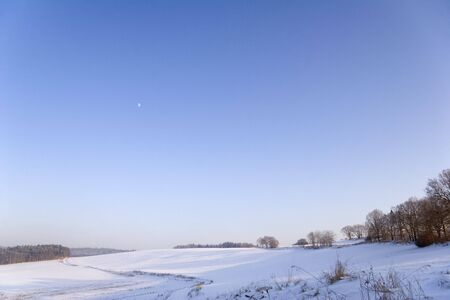 wintriness: fields at wintertime with fresh fallen snow Stock Photo
