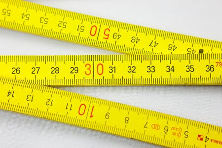 yard stick: folding rule - metering measurement tool to cave out Stock Photo