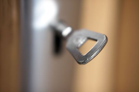 door latch - under lock and key - shallow depth of field Stock Photo - 6644568