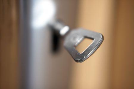 latchkey: door latch - under lock and key - shallow depth of field