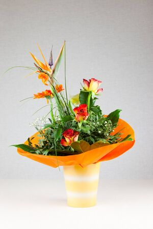 bouquet of flowers - roses, carnations and orchids in a vase photo