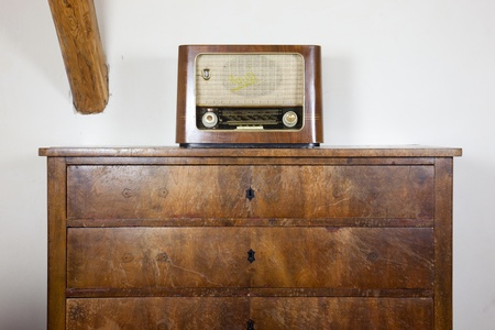 old radio on the old chest of drawers Stock Photo