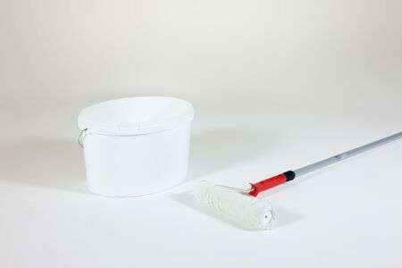 refurbish: white painting with paint roller and bucket Stock Photo