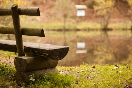 Autumnal forest landscape with a bench on a forest pond Stock Photo - 17898935