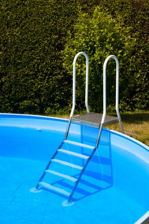 hydrochloric: blue Water in round swimming pool with letter Stock Photo