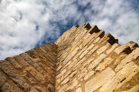 Castle Lobdeburg ruin wall with blue clouded sky