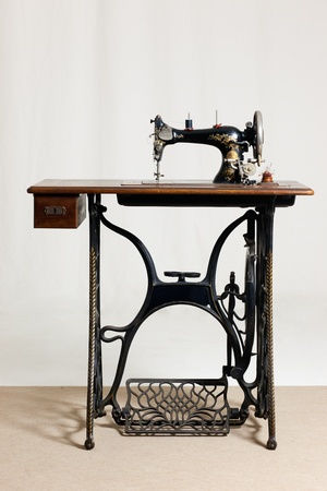 old sewing machine in front of a gray background photo