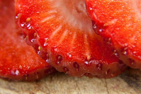 rosoideae: sliced strawberries on a wooden board