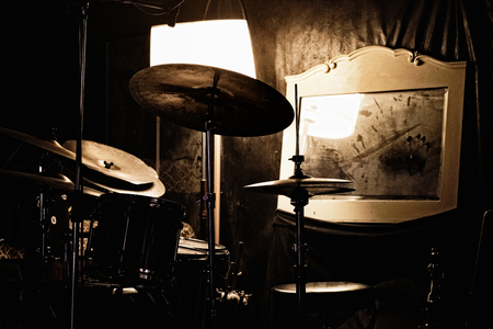 a rehearsal: Drums, mirror and lamp - Detail of a music rehearsal room