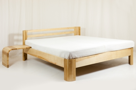 bedstead: wooden bed - piece of furniture in front of white background