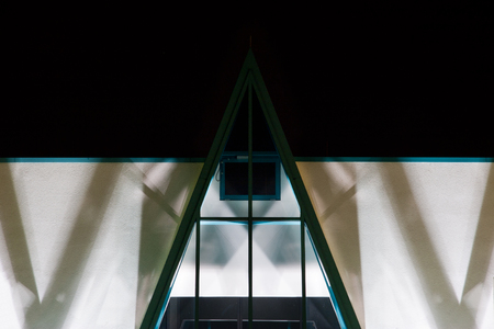 a detail of a modern office building, to night photo
