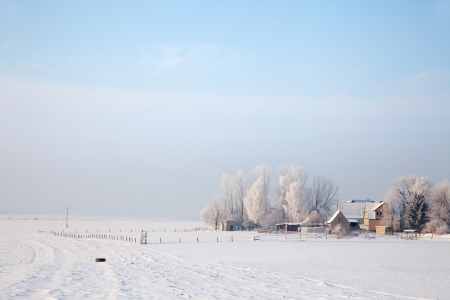 orla: idyllic winter landscape in Thuringia with a rural property