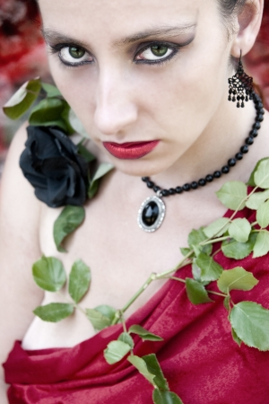 Woman with rose to fling  one s  arms  around  so  s  neck