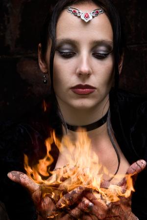 firestarter: Firestarter - a woman with burning hands Stock Photo