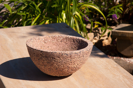 stone bowl: a stone bowl as decoration in the garden Stock Photo