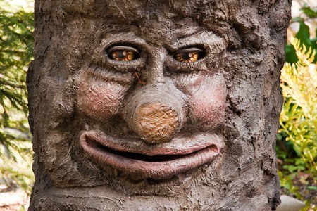 sorcery: a smiling tree with a laughing face Stock Photo