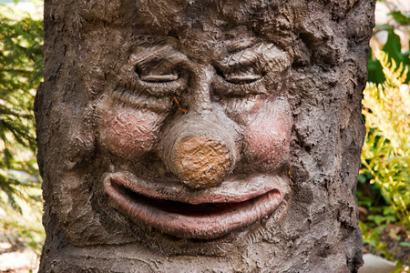 a tree with a face and closed eyes Stock Photo