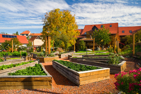 garden center: clay courtyard Lehmhof Lindig - recognized recreation center with Barnyard Cafe, ecological building, clay therapy, shapes with clay, clay playground, Clay Tretbecken, clay sauna, clay bath, massage, herbal Terrace, Raised Bed, Garden Kitchen and holiday Stock Photo