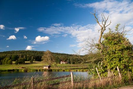 orla: idyllic landscape in springtime with fish farming lake