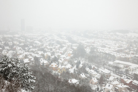 snowlandscape: A view from the Saale horizontally over the city of Jena on a snowy winter day - Thuringia, Germany Stock Photo