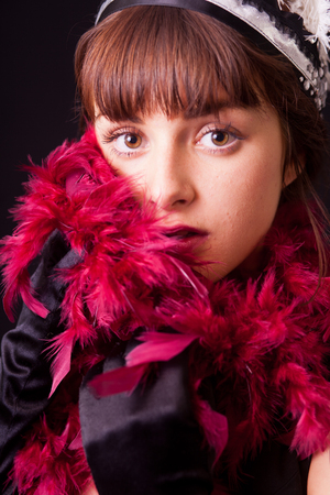 20's: A young woman with feather boa in 20s style
