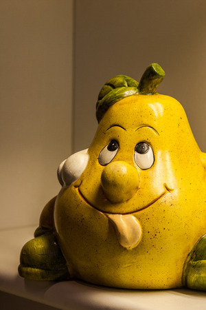droll: Funny pear face with out tongue and cap on head