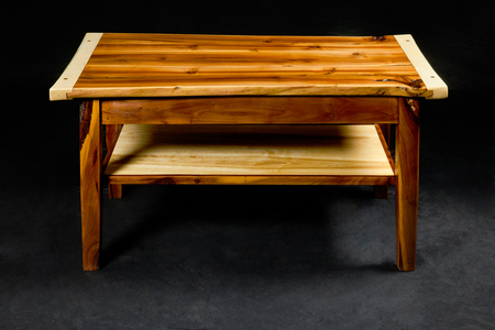 loose fitting: wooden night table - piece of furniture in front of black background