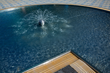 hydrochloric: A paddling pool with small fountain for children Stock Photo