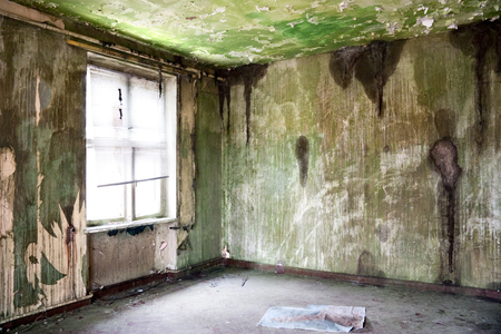 ruinous: old leave deserted room with window, grunge and dirtiness wall Stock Photo