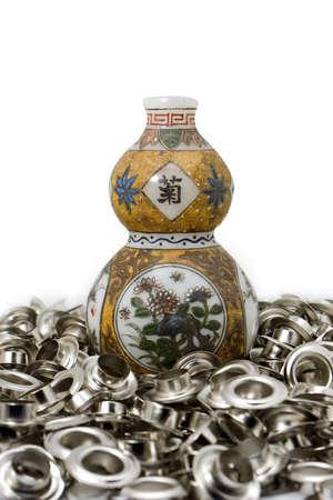 eyelet: Calabash china amulet on eyelet