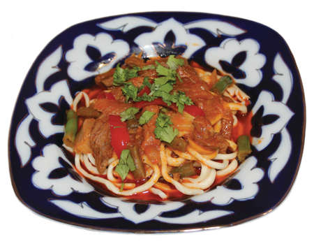 uzbek: Uzbek cuisine, lagman on migurski on white background Stock Photo