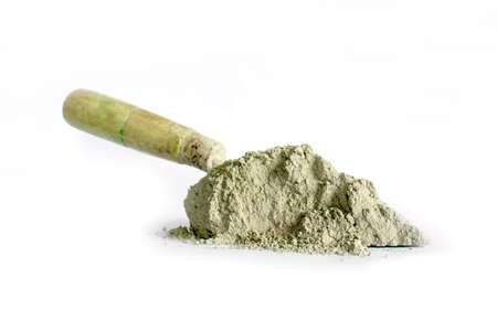 Cement or mortar, including trowel, used for separate construction work on a white background.
