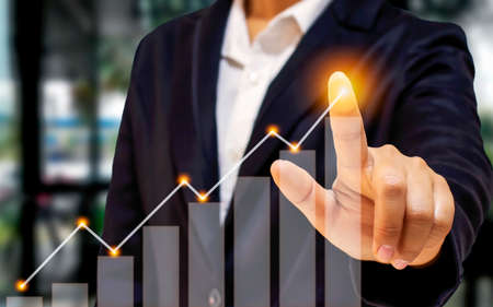 Businessmen point to the arrow on the graph, including the company's future growth plans, business development ideas for increased success and financial growth.