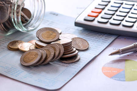 Coins placed on bank accounts, financial business concepts.