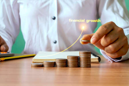 Hand holding coins and rising monetary coins, financial growth concept. investment and financial planning