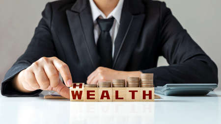 The hands of the businessman flip the square, the square, health and wealth. Financial wealth, life concepts and health insurance investments